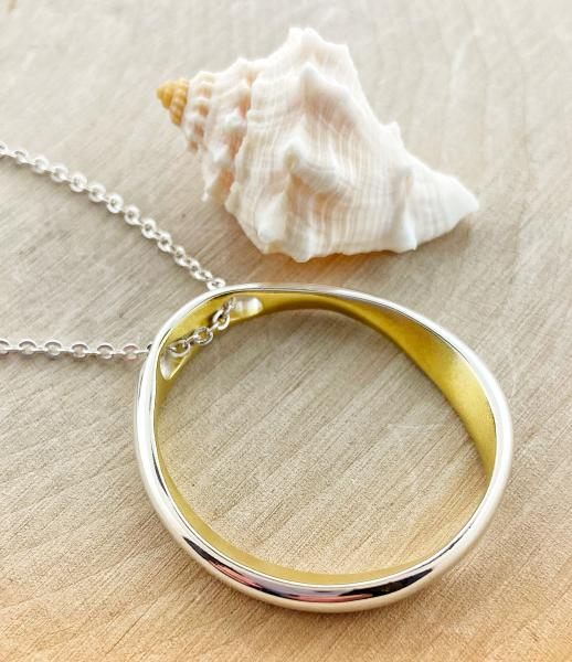 "Sterling silver and yellow gold satin overlay ""O"" necklace. $130.00"