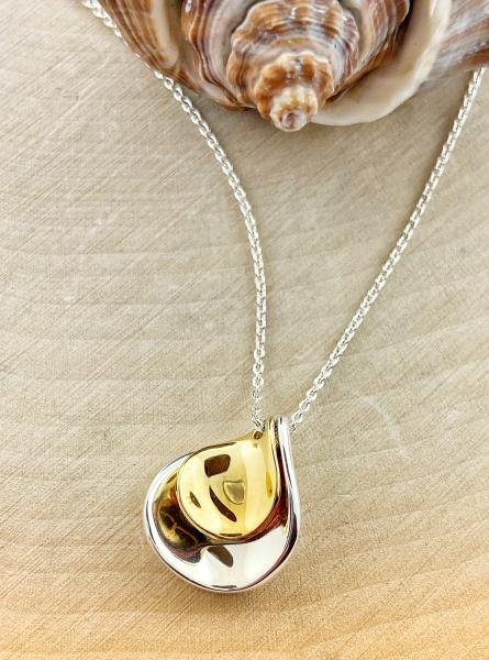 Sterling silver and yellow gold petal drop necklace. $100.00