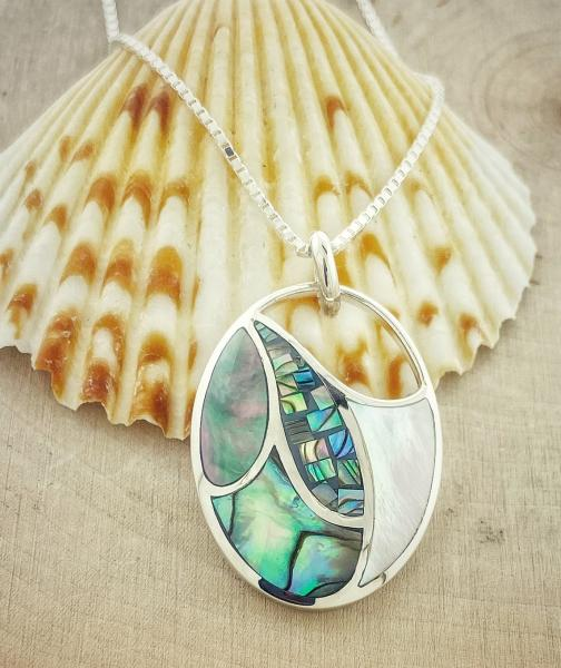 Sterling silver mother of pearl and abalone pendant. $195.00