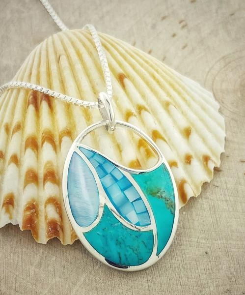 Sterling silver blue mother of pearl and turquoise pendant. $195.00