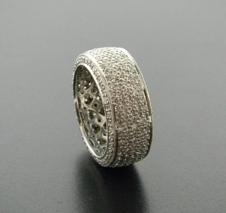 The eternity ring. Pave set brilliant cut diamonds totaling 2.90 carats. Elegantly set in platinum.