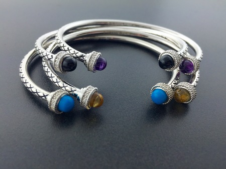 Sterling silver cuff bracelets with diamonds, available in various gemstones.