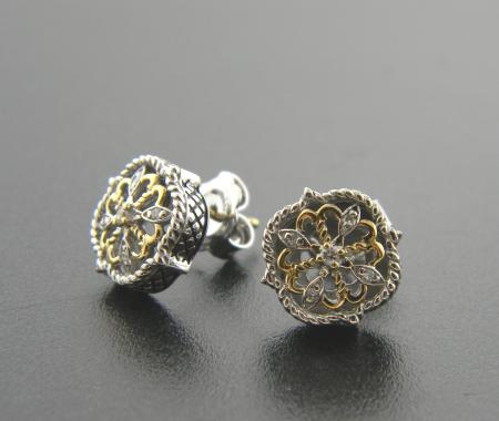 Sterling silver and 18 karat gold earrings with a diamond accent