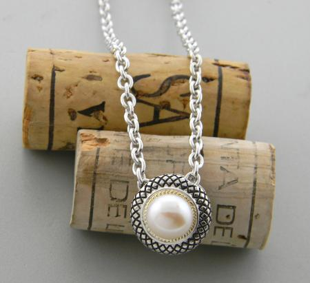 Sterling silver and 18 karat gold freshwater button pearl necklace