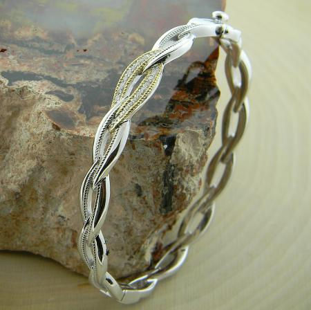 Sterling silver, 18 karat gold and diamond bangle bracelet
