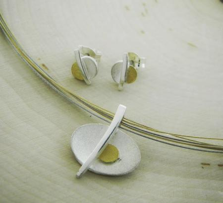 sterling silver and 22 karat gold necklace and earring set