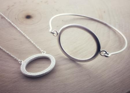 "Sterling silver ""O"" bracelet and necklace"