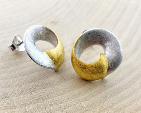 Sterling silver and 14 karat vermeil textured earrings. $189.00