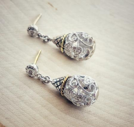 Sterling silver and 18 karat gold dangle filigree design earrings with diamond accents. $375.00
