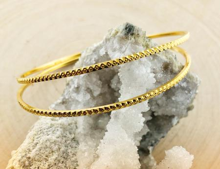 22 karat yellow gold diamond cut design bangles.  $760.00 each