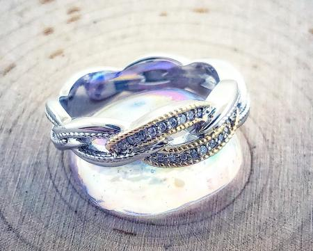 Sterling silver, 18 karat gold and diamond twist ring. $400.00