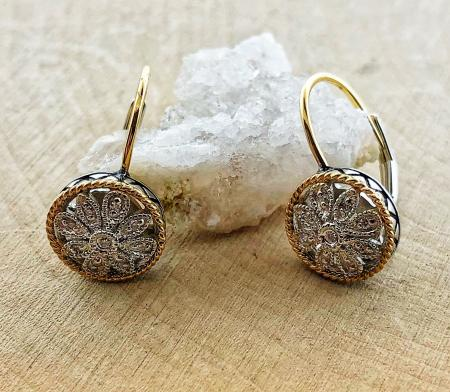 Sterling silver, 18 karat gold and diamond floral design earrings. $350.00