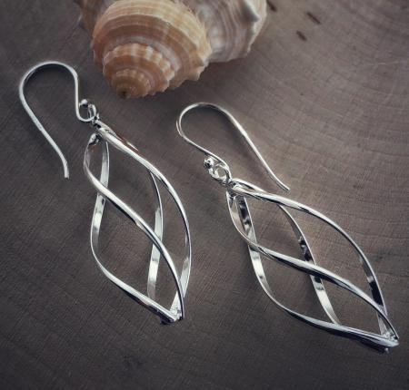 Sterling silver swirl dangle earrings. $60.00