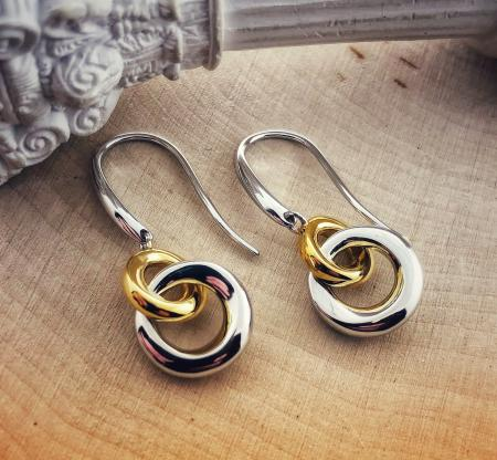 "Sterling silver and yellow gold overlay double ""O"" earrings. $195.00"