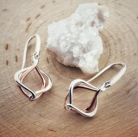 Sterling silver and rose gold overlay entwined earrings. $69.00
