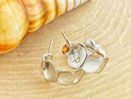 Sterling silver Ginkgo leaf hoop earrings. $231.00