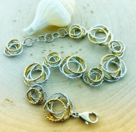 Sterling silver and yellow gold vermeil nest style bracelet. $435.00