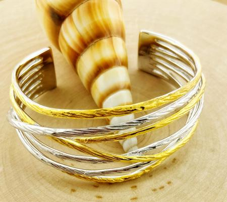 Sterling silver and yellow gold vermeil textured nest style cuff. $650.00