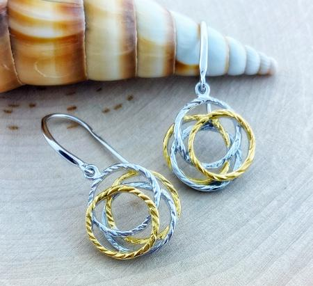 Sterling silver and yellow gold vermeil nest earrings. $198.00
