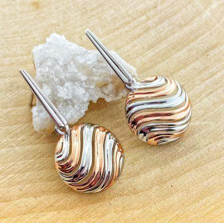 Sterling silver and rose gold vermeil domed swirl design earrings. $204.00