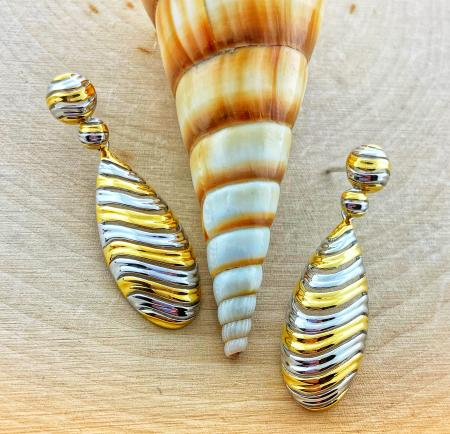 Sterling silver and yellow gold swirl design tear drop earrings. $285.00