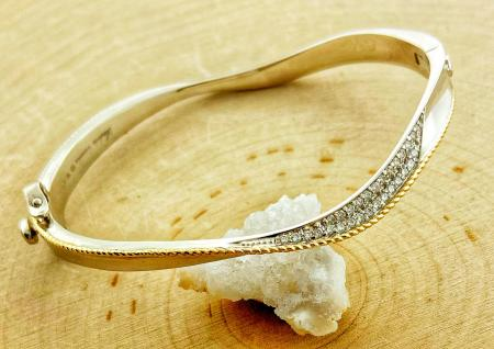Sterling silver and diamond bangle bracelet with 18 karat gold accents. $1100.00