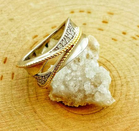 Sterling silver and diamond ring with 18 karat gold accents. $675.00