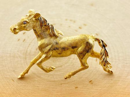 14 karat yellow gold, hand engraved, horse brooch. $2250.00