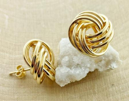14 karat yellow gold triple tube knot earrings. $450.00