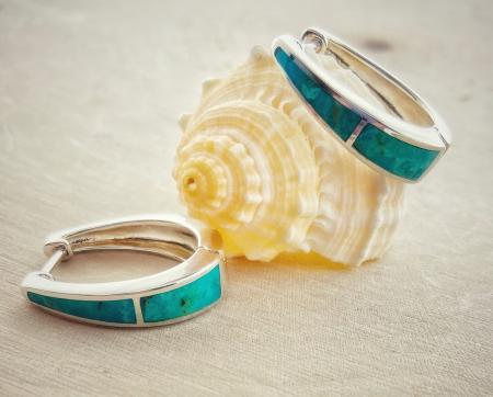 Sterling silver and turquoise hoop earrings. $130.00