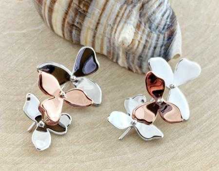 Sterling silver and rose gold overlay blossom petal earrings. $215.00