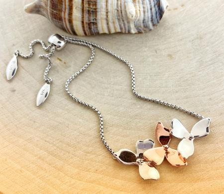 Sterling silver and rose gold overlay blossom petal adjustable bracelet. $160.00