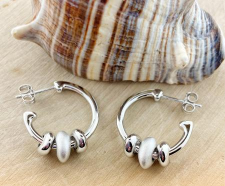 Sterling silver pebble hoops. $122.00