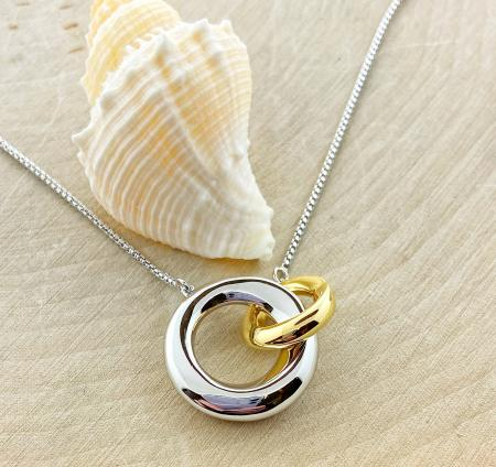 Sterling silver and yellow gold overlay interlocking circle necklace. $195.00