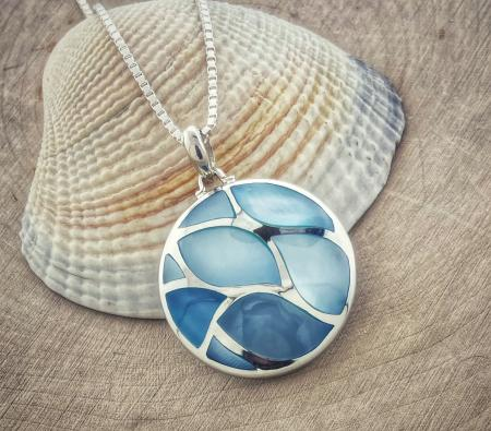 Sterling silver blue mother of pearl inlay pendant. $160.00