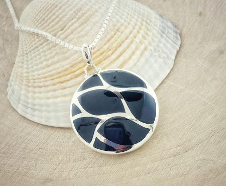 Sterling silver black onyx inlay circle pendant. $160.00