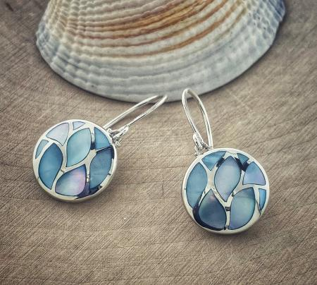 Sterling silver blue mother of pearl circle earrings. $115.00